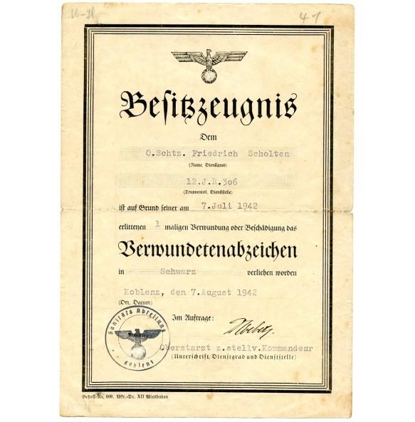Wound badge award document to .Schtz. F. Scholten, IR306, WIA Brjansk