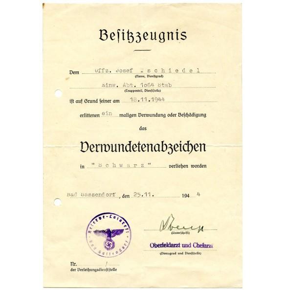 Wound badge in black award document to J. Tschiedel, Einw. Abt 1064