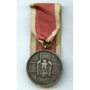 Social welfare medal with swords