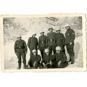 Private snapshot soldiers in winter camouflage helmets