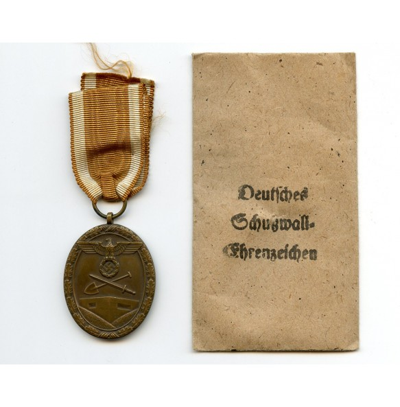 Westwall medal by C. Poellath + package