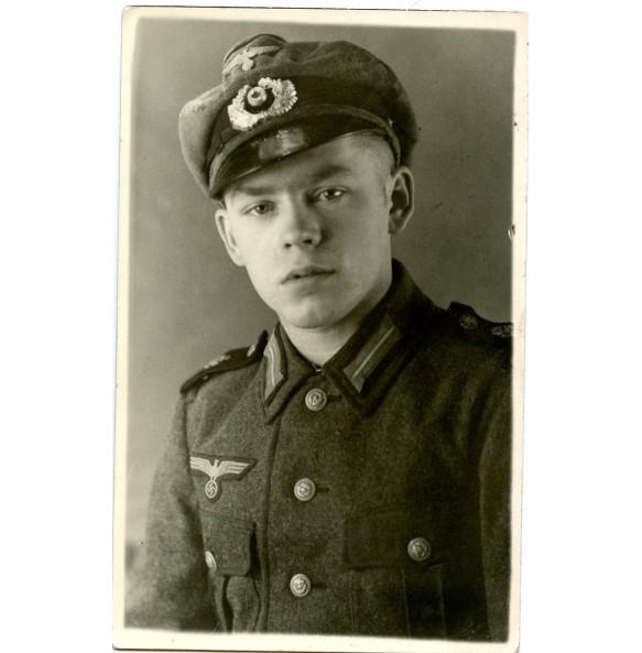 Portrait coastal artillery soldier with visor cap