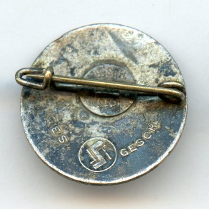 Party pin by Steinhauer & Lück with S&L logo