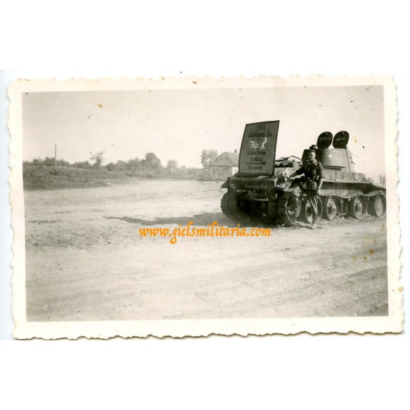 Private snapshot Russian tank used as road mark