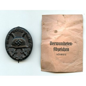 Wound badge in black by C. Wild + small type package