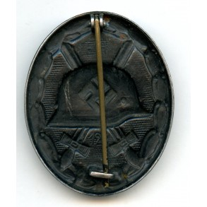 """Wound badge in black by E. Hahn, double maker mark """"EH + 126"""""""