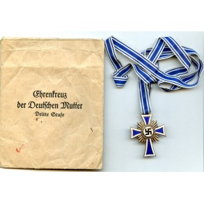 Mother cross in bronze + package by Mauriz Hausch