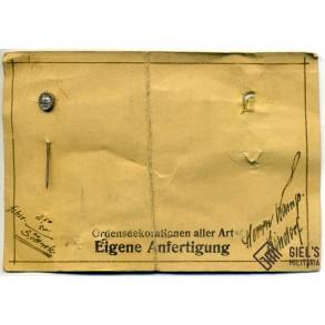 Wound badge in silver on original sales cardboard