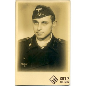 Portrait photo panzermann in black wrapper, one skull