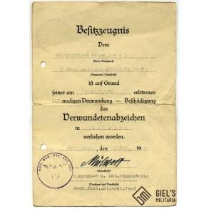 Wound badge in black award document to G. Ewel, Heer Küsten Art. Abt 1003