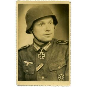 Portrait photo Knights Cross winner with helmet