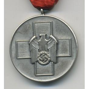 Social welfare medal + package by Gebr. Godet & Co